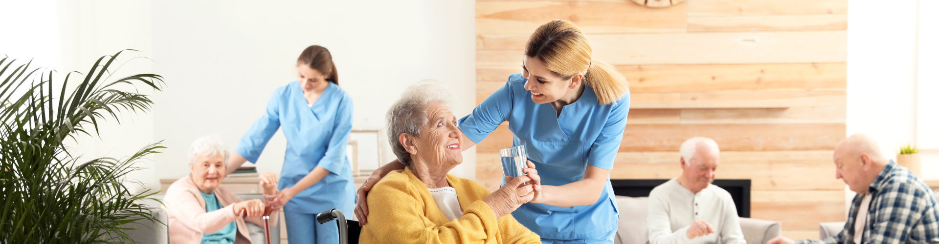 lady caregiver with senior people smiling