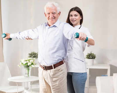 a physical therapist having therapy session with a senior man