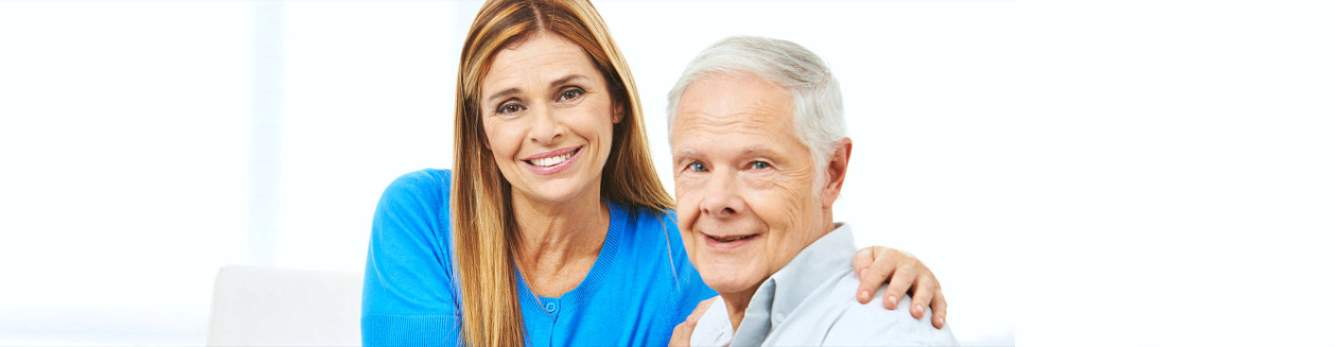 lady caregiver and old man smiling