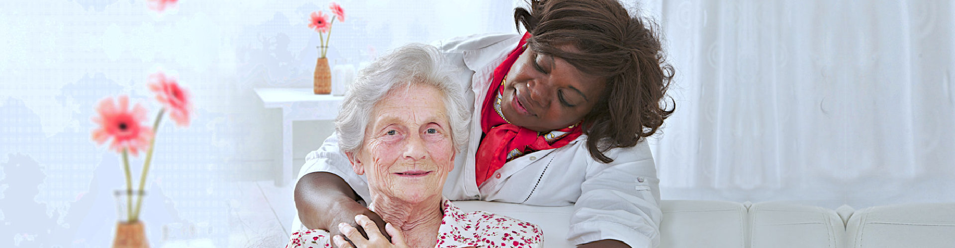 old lady smiling while her caregiver watching her